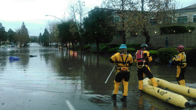 First responders at a flooded street in the Grantville neighborhood. Courtesy San Diego Fire-Rescue