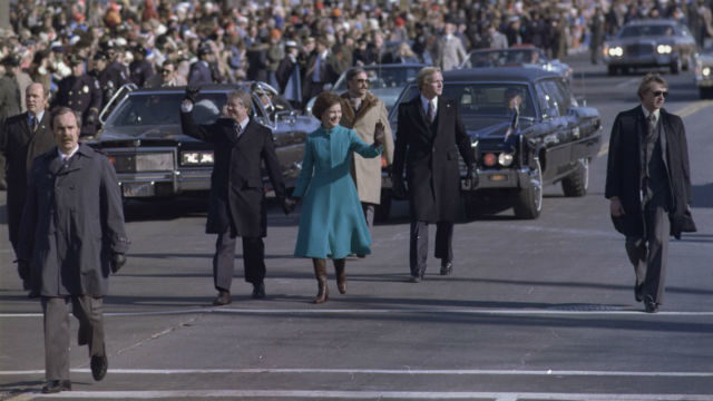 President Jimmy Carter and Rosalynn Carter walk down Pennsylvania Avenue during the Inauguration. Photo from the National Archives