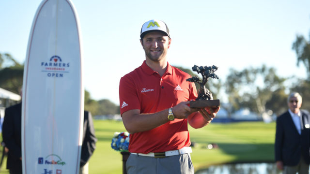 Jon Rahm holds up the trophy for winning the 2017 Farmers Insurance Open golf tournament at Torrey Pines Municipal Golf Course. Photo by Brian Rothmuller/Icon Sportswire