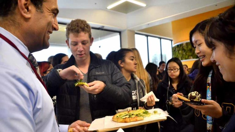Students sample free pizza and other free delights at OceanView Terrace debut. Photo by Chris Stone