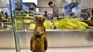 A ceramic rabbit figure stands guard at the salad preparation area. Photo by Chris Stone