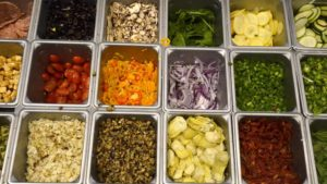 Toppings for pizza make for a colorful array at UCSD restaurant. Photo by Chris Stone