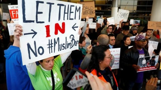 People protest Donald Trump's travel ban from Muslim majority countries at the International terminal at Los Angeles International Airport.  REUTERS/Patrick T. Fallon