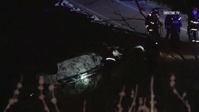 The driver's vehicle came to a stop about 100 feet down a ravine by SR-76. Photo credit: OnScene.TV