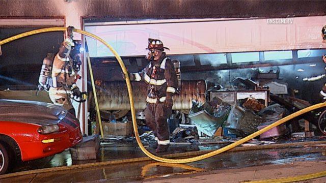 Firefighters outside the destroyed garage. Courtesy OnScene.TV