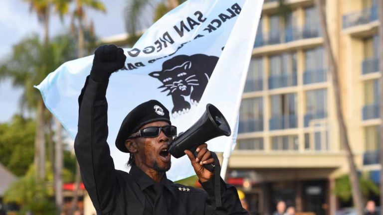 The San Diego chapter of the Black Panther Party marched in the annual Martin Luther King Parade. Photo by Chris Stone