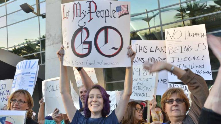 Protesters line both sides of the road in front of Terminal 2 at Lindbergh Field to demonstrate against Donald Trump's immigration order. Photo by Chris Stone
