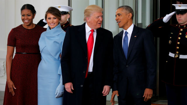 U.S. President Barack Obama and first lady Michelle Obama greet U.S. President-elect Donald Trump and his wife Melania for tea before the inauguration at the White House. REUTERS/Jonathan Ernst