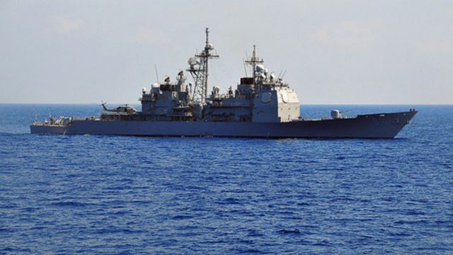 The Ticonderoga-class guided missile cruiser USS Lake Champlain in the Pacific Ocean. Navy photo