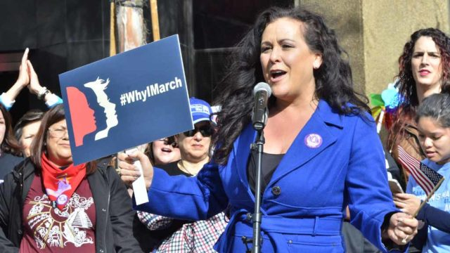 Assemblywoman Lorena Gonzalez Fletcher speaks to the crowd before the march. Photo by Chris Stone