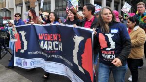California state representatives Lorena Gonzalez (center), Toni Atkins (third from the right) and Todd Gloria (second from the right) lead the march down Broadway. Photo by Chris Stone