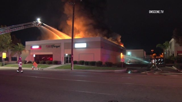 Firefighters battle the blaze at the Escondido dealership. Courtesy OnScene.TV