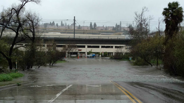 The San Diego River floods Avenida Del Rio at Fashion Valley. Photo by Chris Jennewein