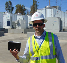 SDG&E's Josh Gerber with one of the batteries.