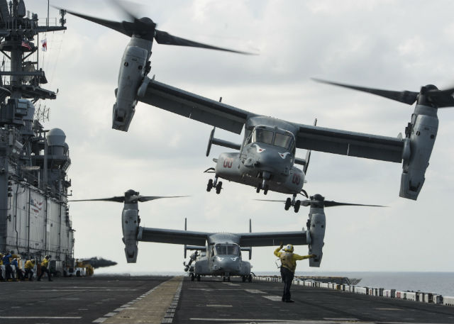 Aviation Boatswain's Mate 3rd Class Jalisa Hill signals an MV-22B Osprey to take off. Photo by Mass Communication Specialist 3rd Class Devin M. Langer