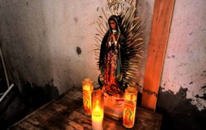 A statue of Our Lady of Guadalupe sits in the corner of a shelter. Photo by Chris Stone