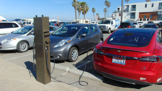 Electric vehicles lined up at the Ocean Beach charging stations. Photo by Chris Jennewein