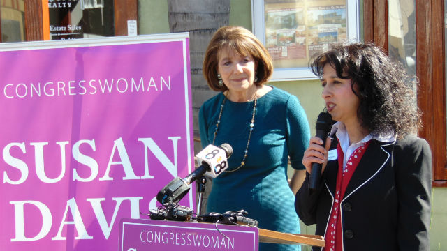 Rep. Susan Davis (left) and Roxanne Govari of Pemberley Realty outside her University Heights business. Photo by Chris Jennewein