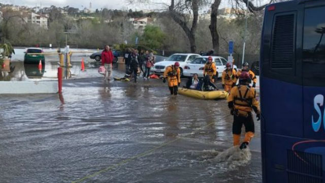SD Lifeguards and SDFD evacuate Mission Valley hotel due to flooding. Courtesy San Diego Fire-Rescue