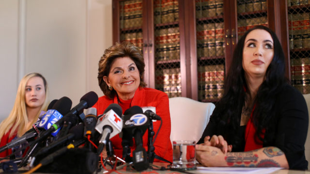 Attorney Gloria Allred represents two female United States Marines, active duty Marine Marisa Woytek (left) and former Marine Erika Butner (right) during a press conference in Los Angeles.    REUTERS/Mike Blake
