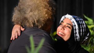 Mona Dibas, Southwestern College Associated Student Organization president, hugs Angela Davis after introducing her. Photo by Chris Stone