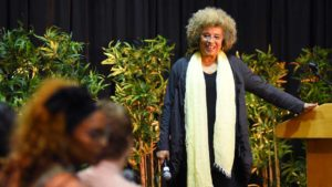 Angela Davis listens as audience members ask questions after the speech. Photo by Chris Stone
