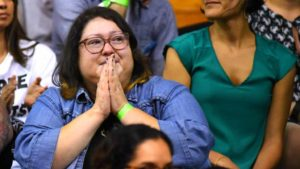 An audience member reacts to Angela Davis' talk at Southwestern College. Photo by Chris Stone