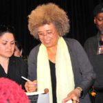 Angela Davis autographs books after her 90-minute appearance. Photo by Chris Stone