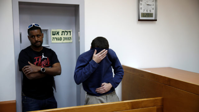 A U.S.-Israeli teen)arrested in Israel on suspicion of making bomb threats against Jewish community centres is seen before the start of a court hearing in Rishon Lezion, Israel. REUTERS/Baz Ratner