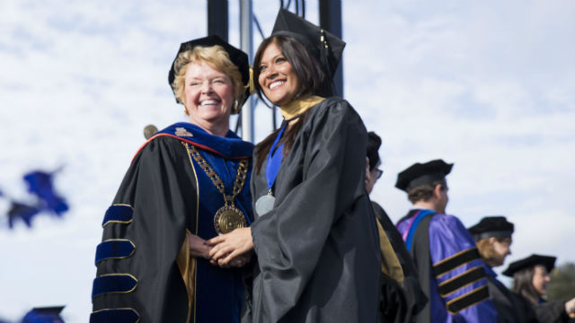 Dr. Karen Haynes (left) with a graduating student. Courtesy of Cal State San Marcos