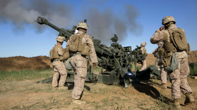 Marines in Iraq, fire an M777A2 Howitzer. Courtesy Defense Department