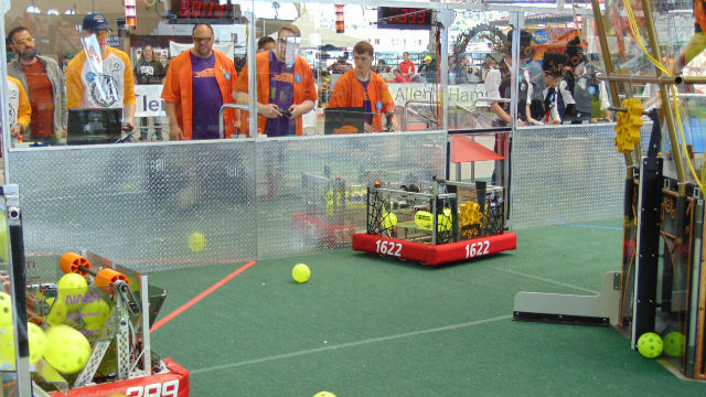 Robot team members direct their machines to collect wiffle balls. Photo by Chris Jennewein
