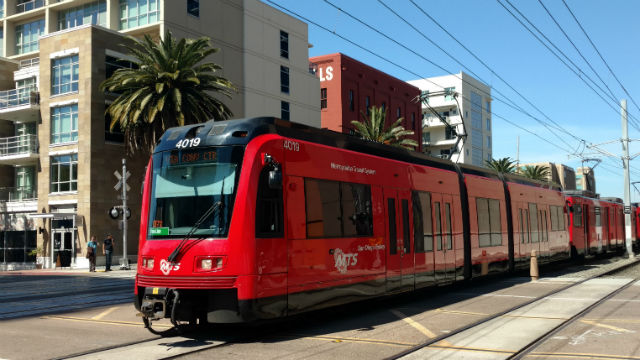 An MTS trolley leaves the Little Italy station in downtown San Diego. Photo by Chris Jennewein