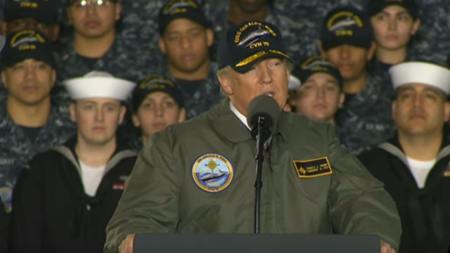 President Trump speaks aboard the future USS Gerald R. Ford. Image from Defense Department video