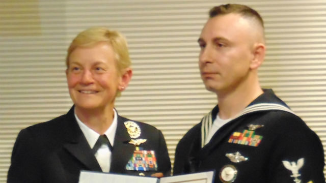 Vice Adm. Nora Tyson and Petty Officer Michael Carfaro. Photo by Chris Jennewein