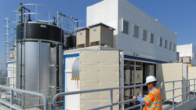 An engineer inspects the vanadium redox flow battery storage facility in Bonita. Photo by Chris Jennewein