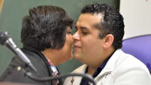 Democrats for Equality President Will Rodriguez-Kennedy gives kiss to Councilwoman Georgette Gómez