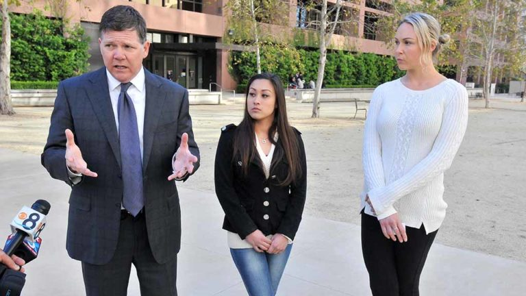 Dan Gilleon answers questions on the case alongside former Cheetahs dancer Renee L. (left)  and Mallory M.