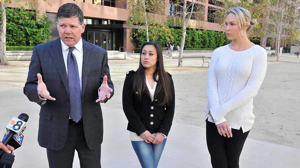 Dan Gilleon answers questions on the case alongside former Cheetahs dancer  Renee L. (left
