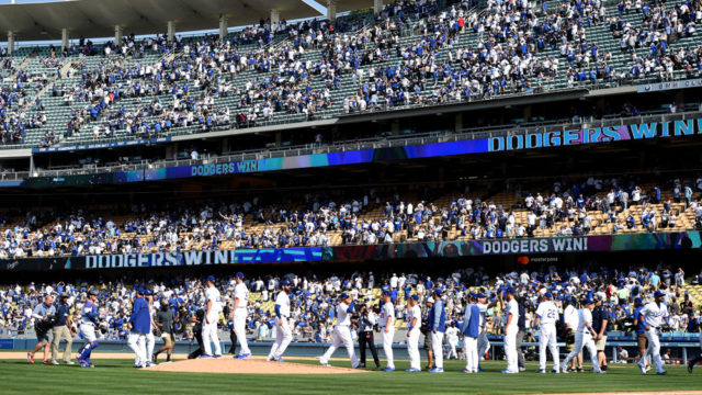 The Dodgers celebrate their victory during in the opening day game against the San Diego Padres. Photo by Chris Williams/Icon Sportswire
