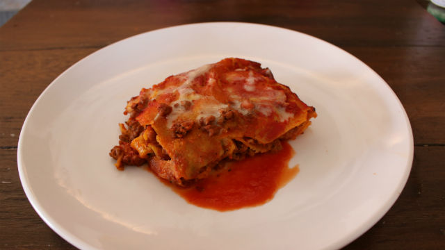 A classic Italian sausage lasagna known as 'Lasagna Romagnola,' sprinkled with vegan parmigiano. Photo by Cassia Pollock.