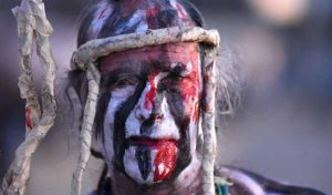 """""""Dead"""" Alan James dresses in war paint during many of his performances. Photo by Chris Stone"""