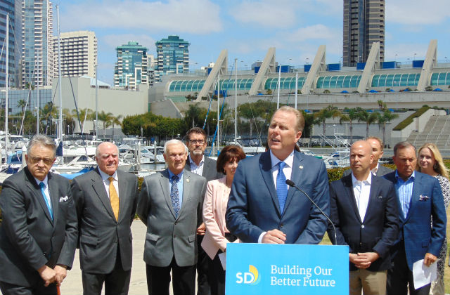 Mayor Kevin Faulconer, joined by business and political leaders, announces the ballot measure in front of the San Diego Convention Center. Photo by Chris Jennewein