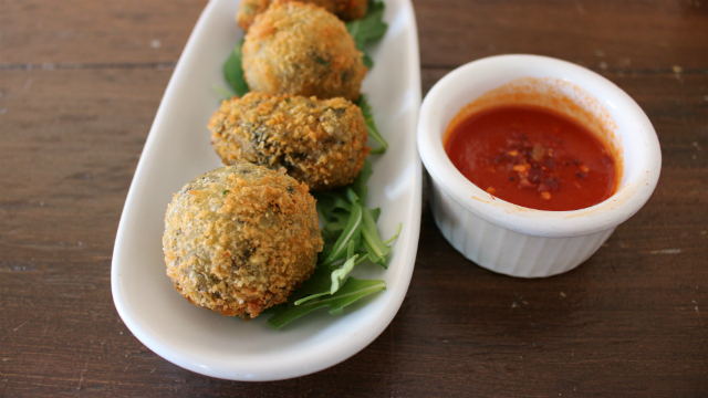 A spicy sauce served with breaded potato croquettes.