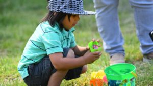 Julian, 4, of San Diego cracks open his plastic eggs to find his candy. Photo by Chris Stone