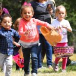 Young children run toward 500 plastic eggs scattered in El Monte County Park in Lakeside.