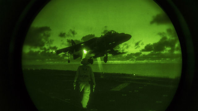 An AV-8B Harrier lands on the flight deck of the amphibious assault ship USS Makin Island during night vision flight operations. Navy photo by Mass Communication Specialist 3rd Class Devin M. Langer