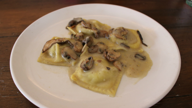 House-made 'Ravioli Boscaiola' filled with Truffle Wild Mushrooms sauce. Photo by Cassia Pollock.