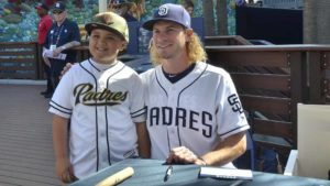 A young fan proudly poses with outfielder Travis Jankowski. Photo by Chris Stone