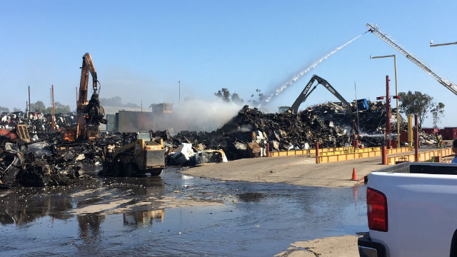 Firefighters douse the burning scrap yard with water. Courtesy San Diego Fire-Rescue